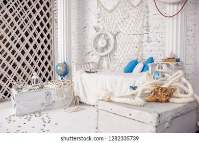 Beautiful location in a photo Studio in a sea style in white colors for a photosession on a brick wall background