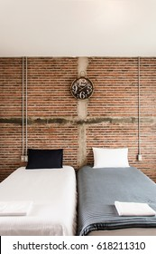 Beautiful loft style bedroom with brick wall