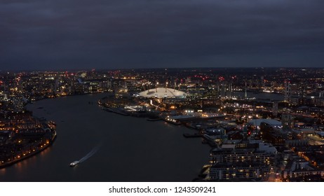 Beautiful London Riverside Skyline and Cityscape Aerial Night View feat. River Thames, The O2 Arena - Millennium Dome is large entertainment district on the Greenwich in South East London, England UK