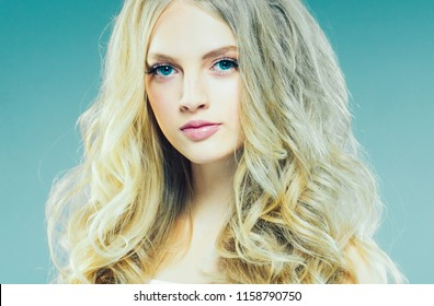 Beautiful long blonde hair woman closeup face portrait beauty hairstyle