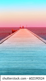 Beautiful long bridge goes out to sea at sunset
