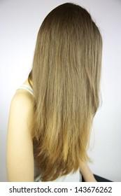 beautiful long brunette tending to blond hair