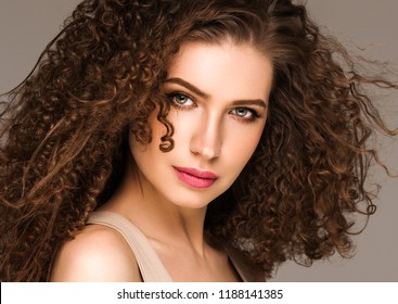 Beautiful long curly woman brunette nice face perfect hairstyle
