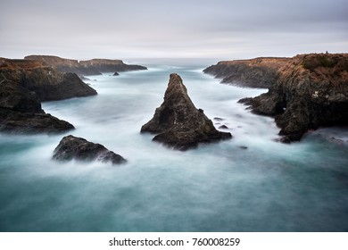 Beautiful long exposure landscape photograph of Pacific Coast along Highway 1. Rock formations in Mendocino Headlands State Park, California