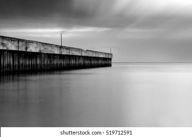 Beautiful long exposure seascape view with  jetty in black and white. Nature composition.
