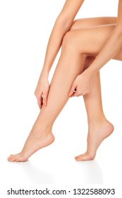 Beautiful long female legs, unwanted hair removal concept. Skin care. White background, isolated