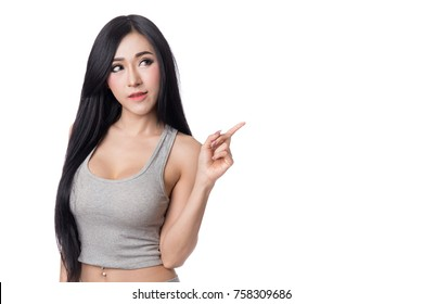 beautiful long hair asian women pointing to copy space, isolated on white background
