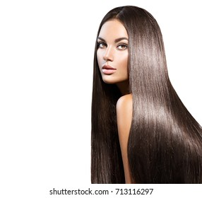 Beautiful long Hair. Beauty woman with luxurious straight brown hair. Beautiful brunette Model, Healthy Hair. Lady with long smooth shiny straight hair. Hairstyle, cure. Isolated on white background