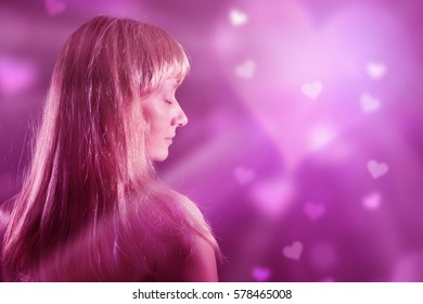 Beautiful long hair blonde woman with eyes closed dreaming about love.