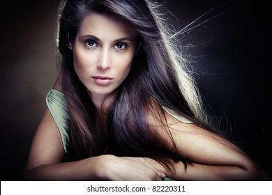 beautiful long hair brunette woman,  small amount of grain added, studio shot