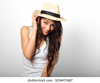68142555dd6 Beautiful long hair fun laughing woman in white top and straw hat looking  happy on white