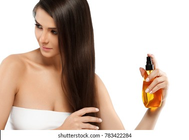 Beautiful long hair girl with oil cosmetic beauty skin care concept. Young woman female model spa with oil skincare