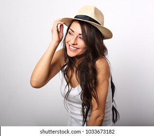 cf7bfa4c8e1 Beautiful long hair laughing woman in white top and straw hat looking happy  on white background