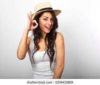 4a18e6c47f3 Beautiful long hair laughing woman showing fingers the ok sign in white  top