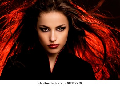 beautiful long hair young woman portrait with dark makeup, studio