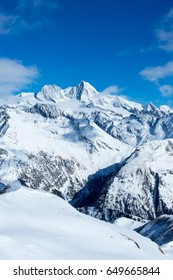 Beautiful long shot of Austria's highest mountain, the Grossglockner, on a sunny winter day.