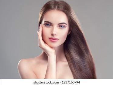 Beautiful long smooth healthy brunette hair woman beauty portrait