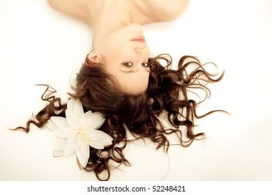 beautiful long-haired girl lying