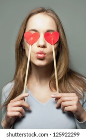 beautiful love a girl with hearts in the hands sends a kiss, a girl with hearts for eyes