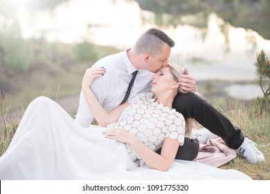 beautiful love people, newlyweds, a young couple, outdoor session. The bride in a white dress. Love, wedding, passion and a thoughtful kiss