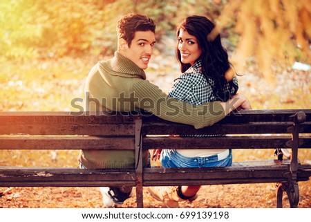Beautiful teen blows his boyfriend in the park