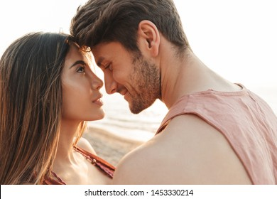 Beautiful lovely young couple in love spending time at the beach