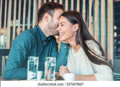 Beautiful loving couple flirting in a cafe. Love and romance. Lifestyle concept