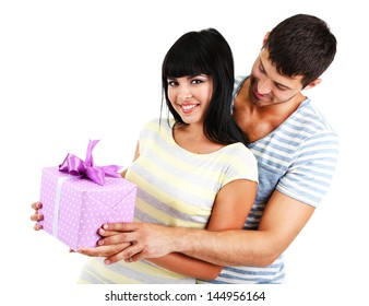 Beautiful loving couple with gift isolated on white - Shutterstock ID 144956164