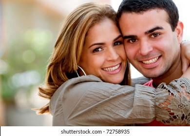Beautiful loving couple hugging and having fun
