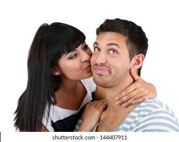 Beautiful loving couple kissing isolated on white