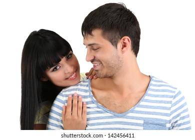 Beautiful loving couple together isolated on white