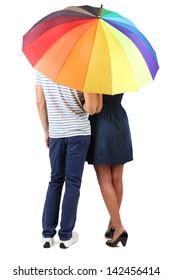 Beautiful loving couple with umbrella isolated on white