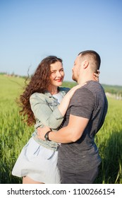 beautiful loving couple in a wheat field. casual style