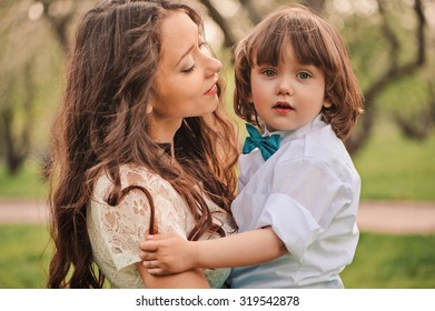 beautiful loving mother with cute toddler son on the walk