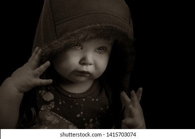 Beautiful Low key Image of a baby Girl On Black