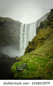 The beautiful lush green pathway leading up to the famous Skogafoss waterfall in Iceland.