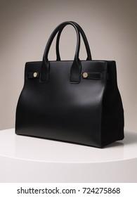 Beautiful luxury black female leather bag on a beige background
