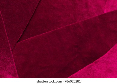 Beautiful luxury dark purple patchwork velvet texture background cloth. flaps of velvet fabric with a reflection