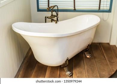 Beautiful luxury elegance white bathtub decoration interior of bathroom for spa relax concept