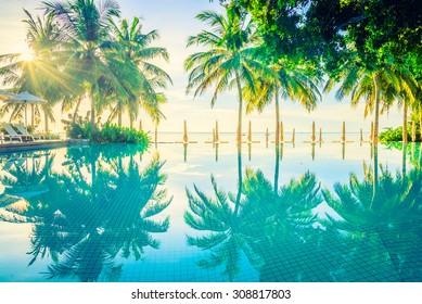 Beautiful luxury hotel pool resort neary beach - Vintage filter effect processing