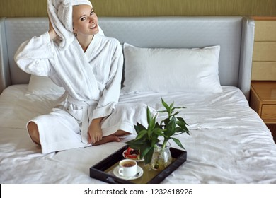 Beautiful Luxury Life. Breakfast. Happy Girl with a Cup of Coffee. Home Style Relaxation Woman Wearing Bathrobe and Towel after Shower. Spa Good Morning.