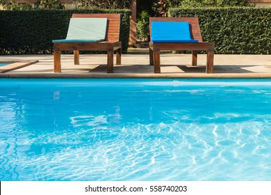 Beautiful luxury outdoor swimming pool with the lounge chair at poolside in the resort.