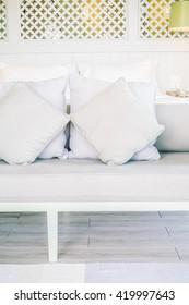 Beautiful luxury pillow on sofa decoration in bedroom interior - Vintage light Filter