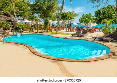 Beautiful Luxury Swimming Pool With Rattan Deck Chairs