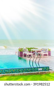 Beautiful luxury Swimming pool resort hotel with stairs pool - Vintage Filter and sunflare effect processing - Shutterstock ID 391982512
