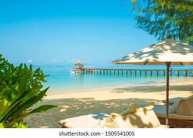 Beautiful luxury tropical Island Resort, Beach, jetty, early morning, sand and sea, blue sky