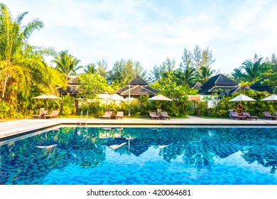 Beautiful luxury umbrella and chair around swimming pool in hotel resort - Boost up color Processing