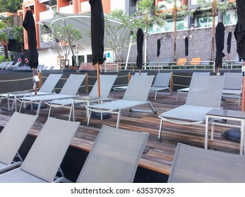 Beautiful luxury umbrella and chair around outdoor swimming pool in hotel resort