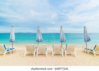 Beautiful luxury umbrella and chair on sea and beach