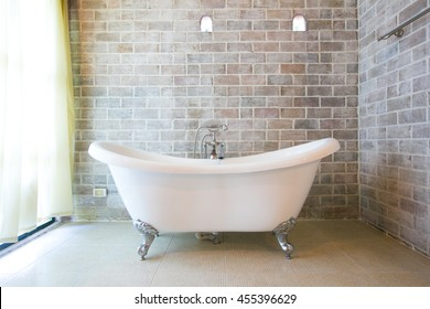 Beautiful luxury vintage bathtub decoration in bathroom interior - Vintage filter
